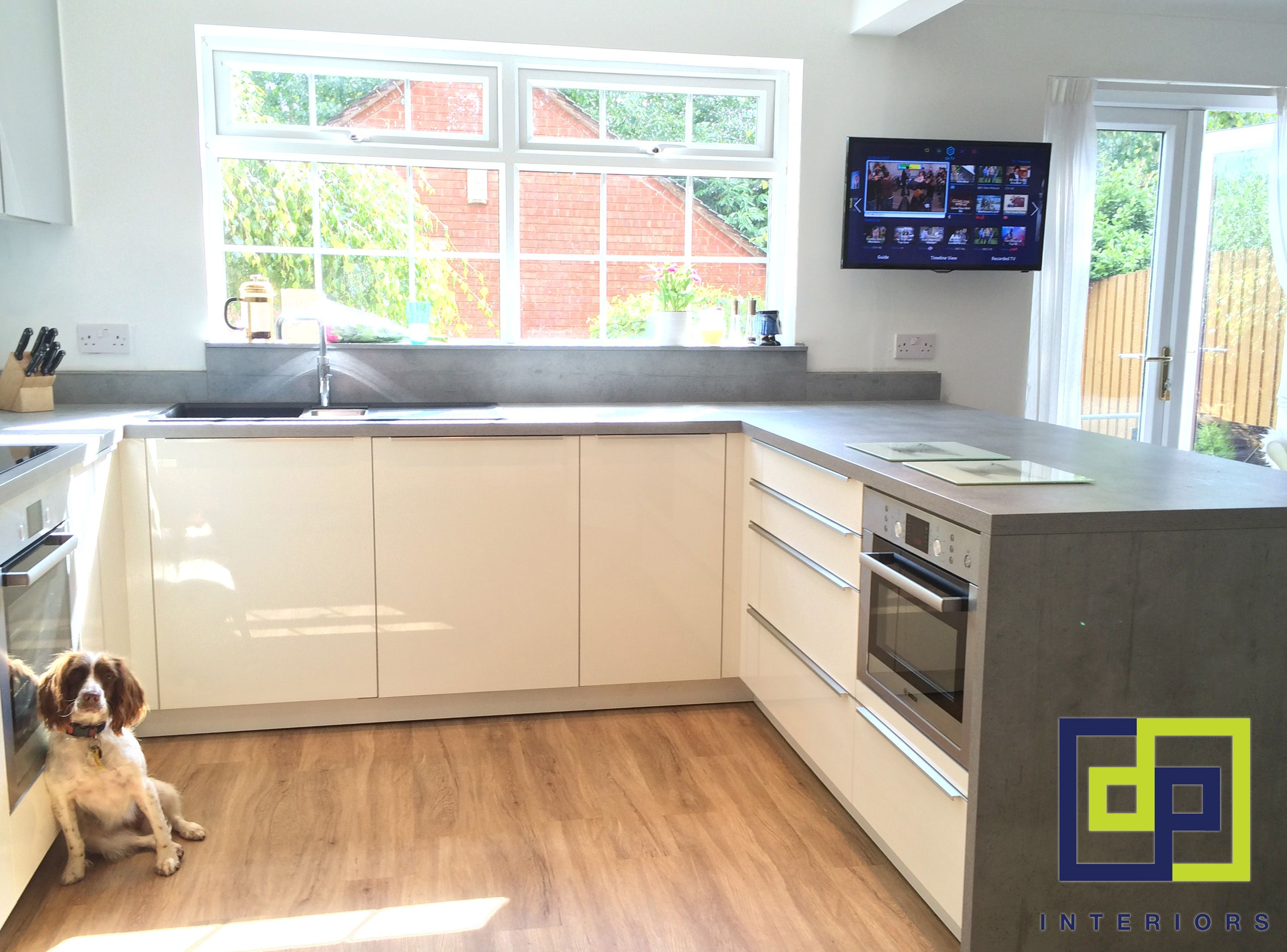 cream gloss kitchen with concrete effect laminate worktops