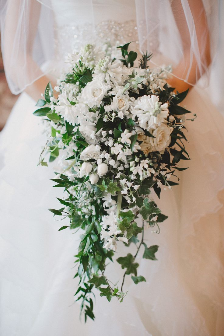 Cascading Wedding Bouquet Featuring White Roses