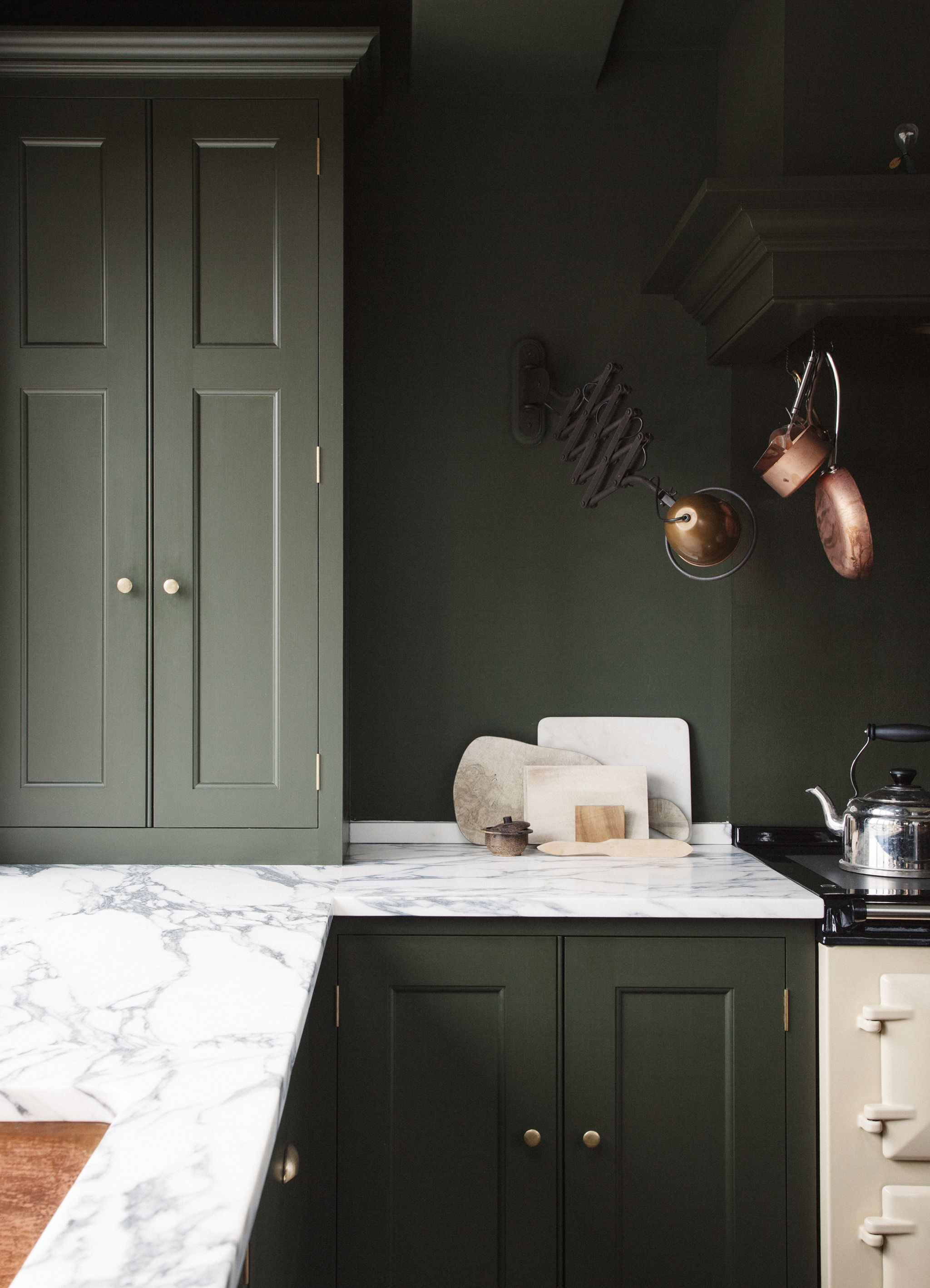 green kitchen and matching wall colour