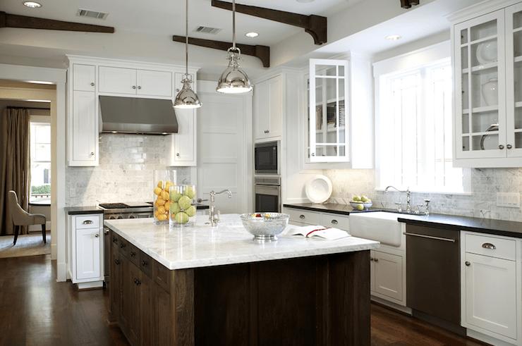 White farmhouse style kitchen with glass front