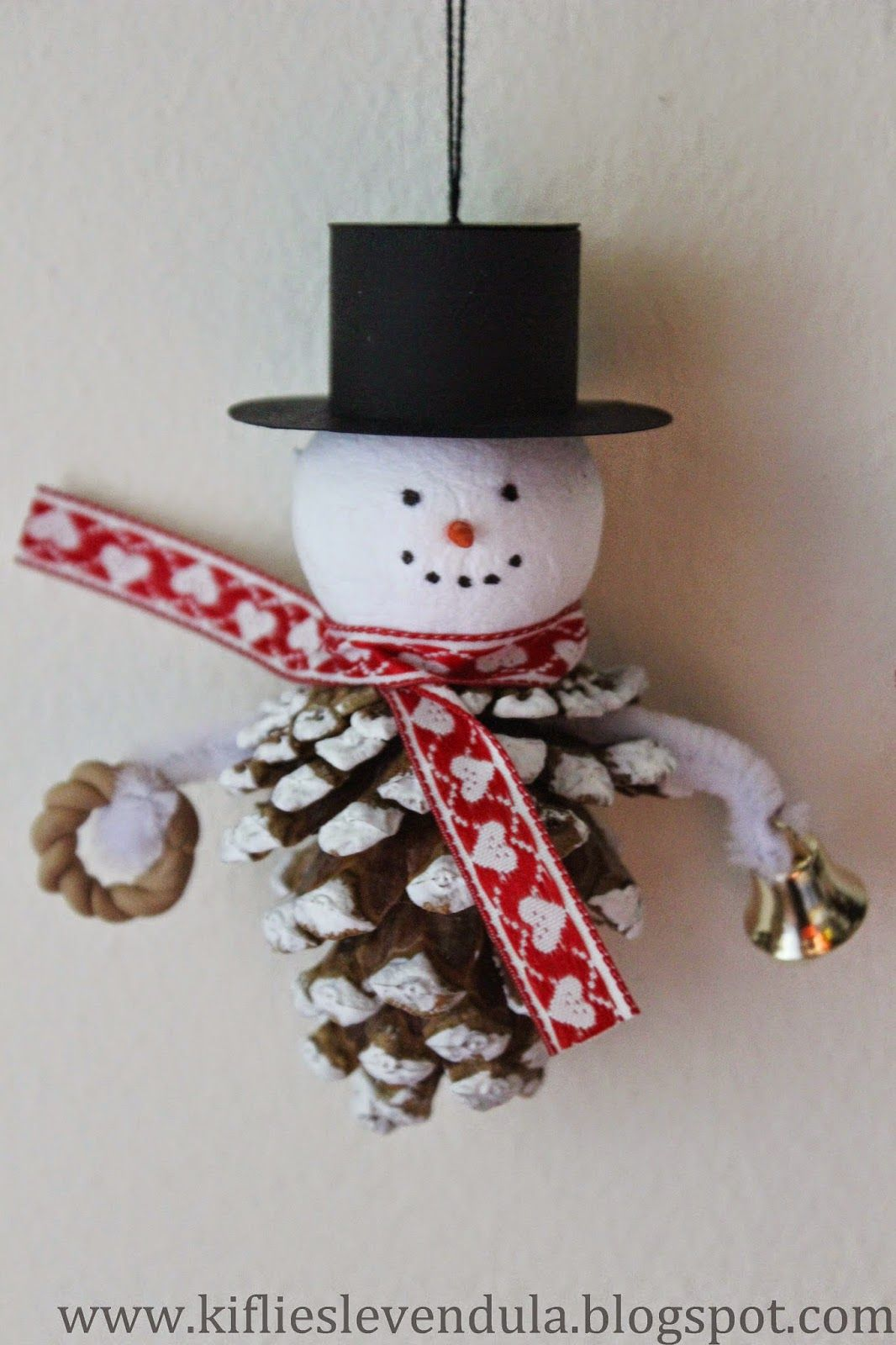 Snowman ornament made with pinecone and styrofoam ball