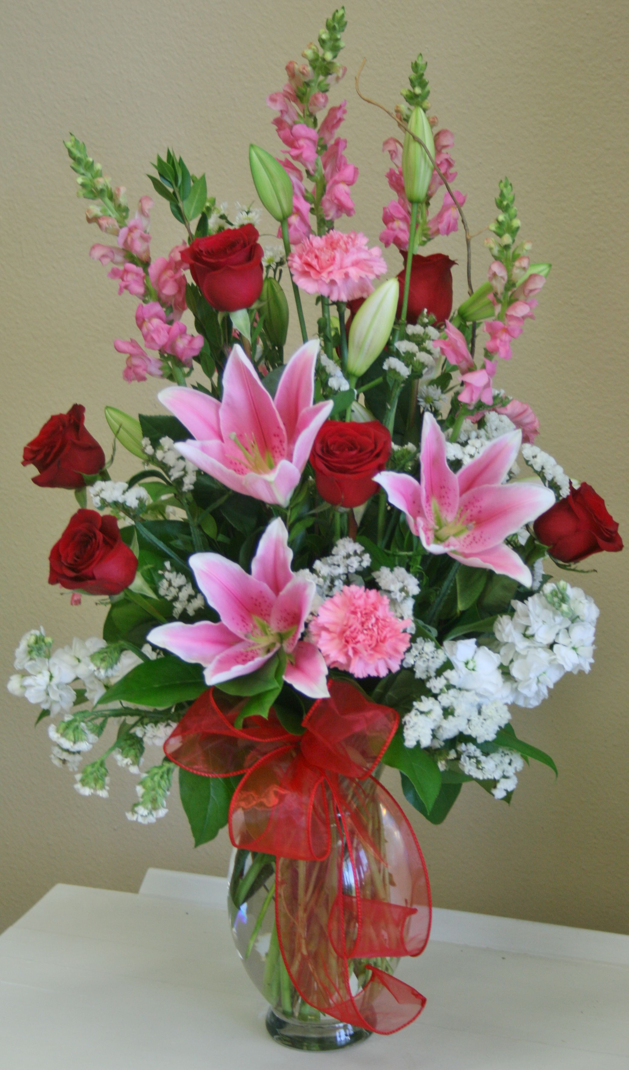 A romantic red, white and pink flower arrangement by your