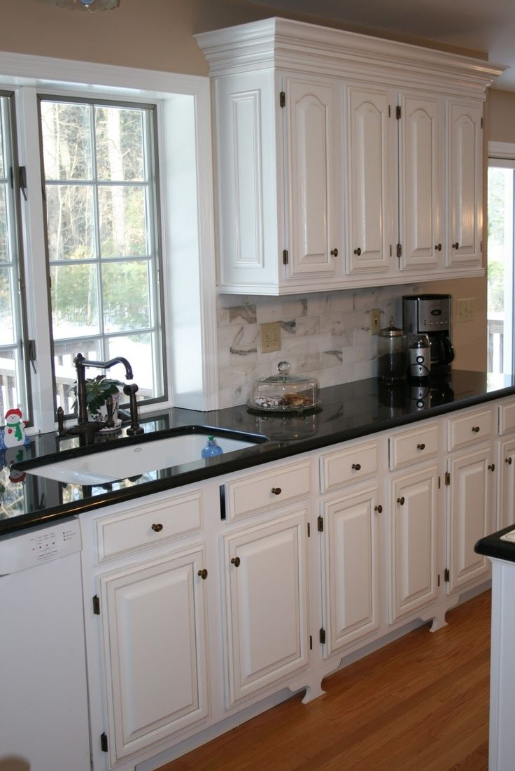 White Kitchens with Black Countertops White