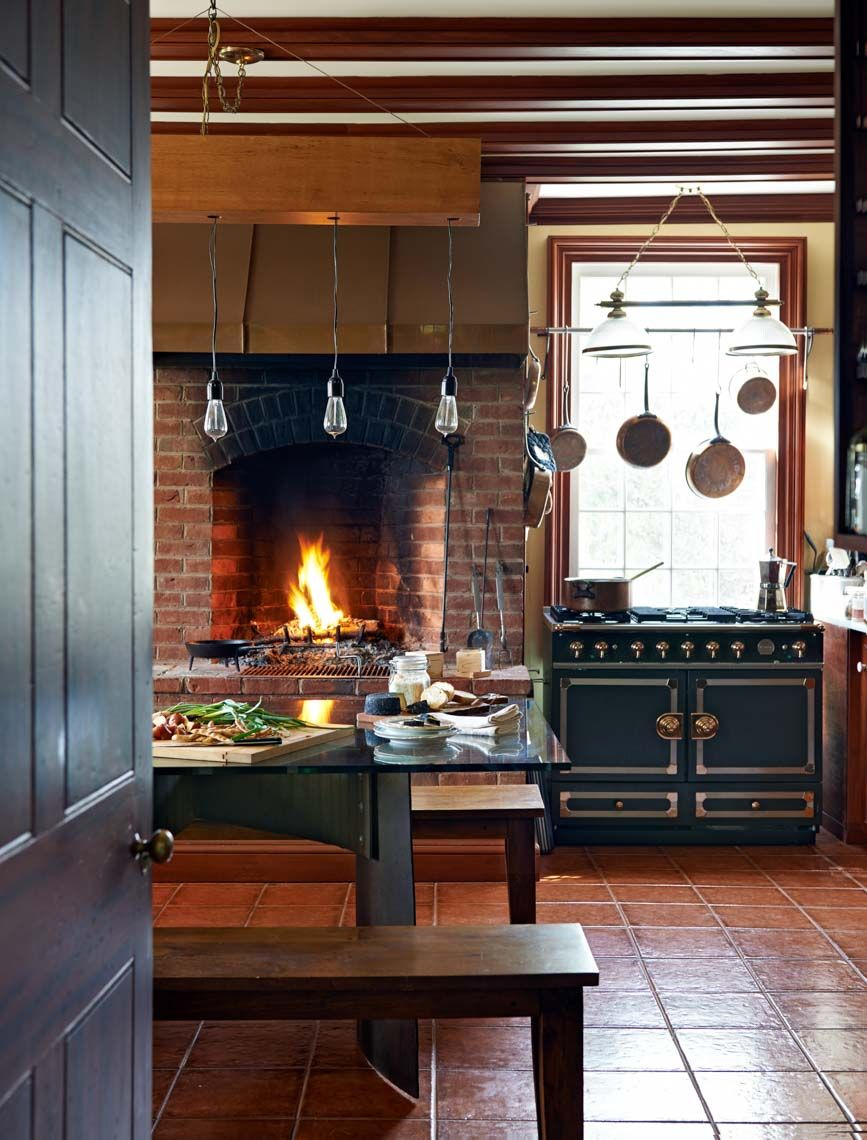 rustic modern kitchen with fireplace + trophy cook stove