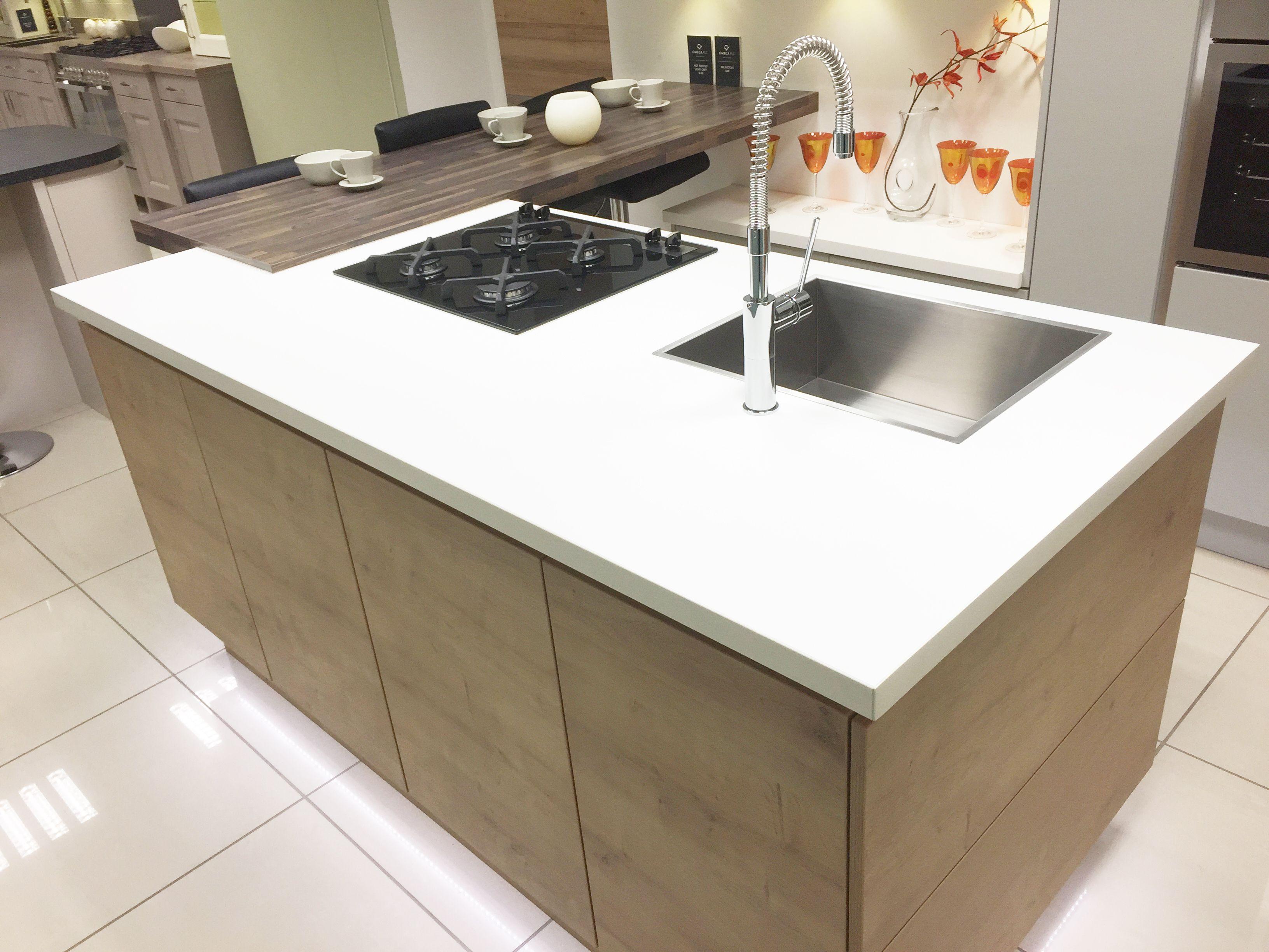 Modern kitchen island with hob, sink and breakfast bar