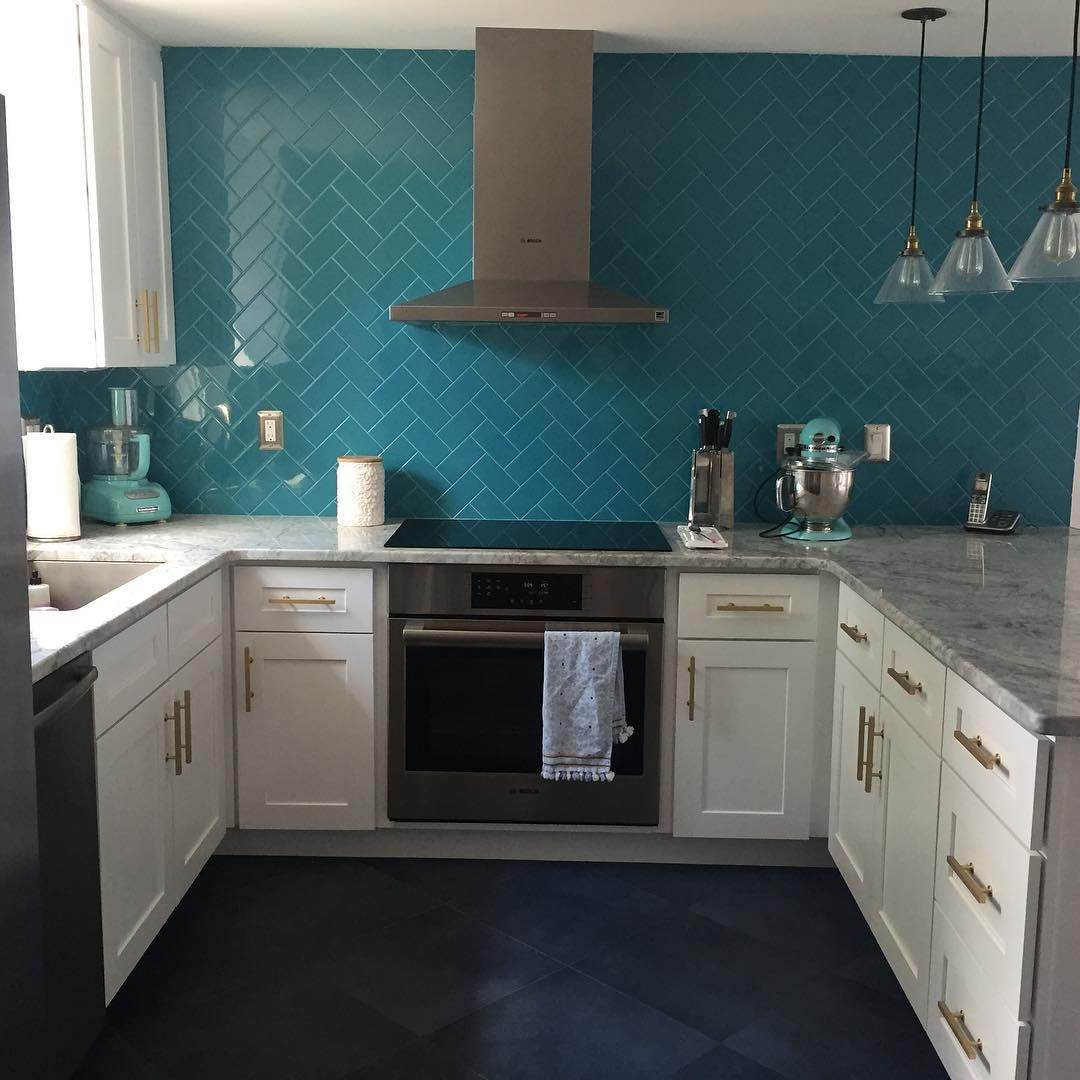 Amazing kitchen! Teal herringbone backsplash, white