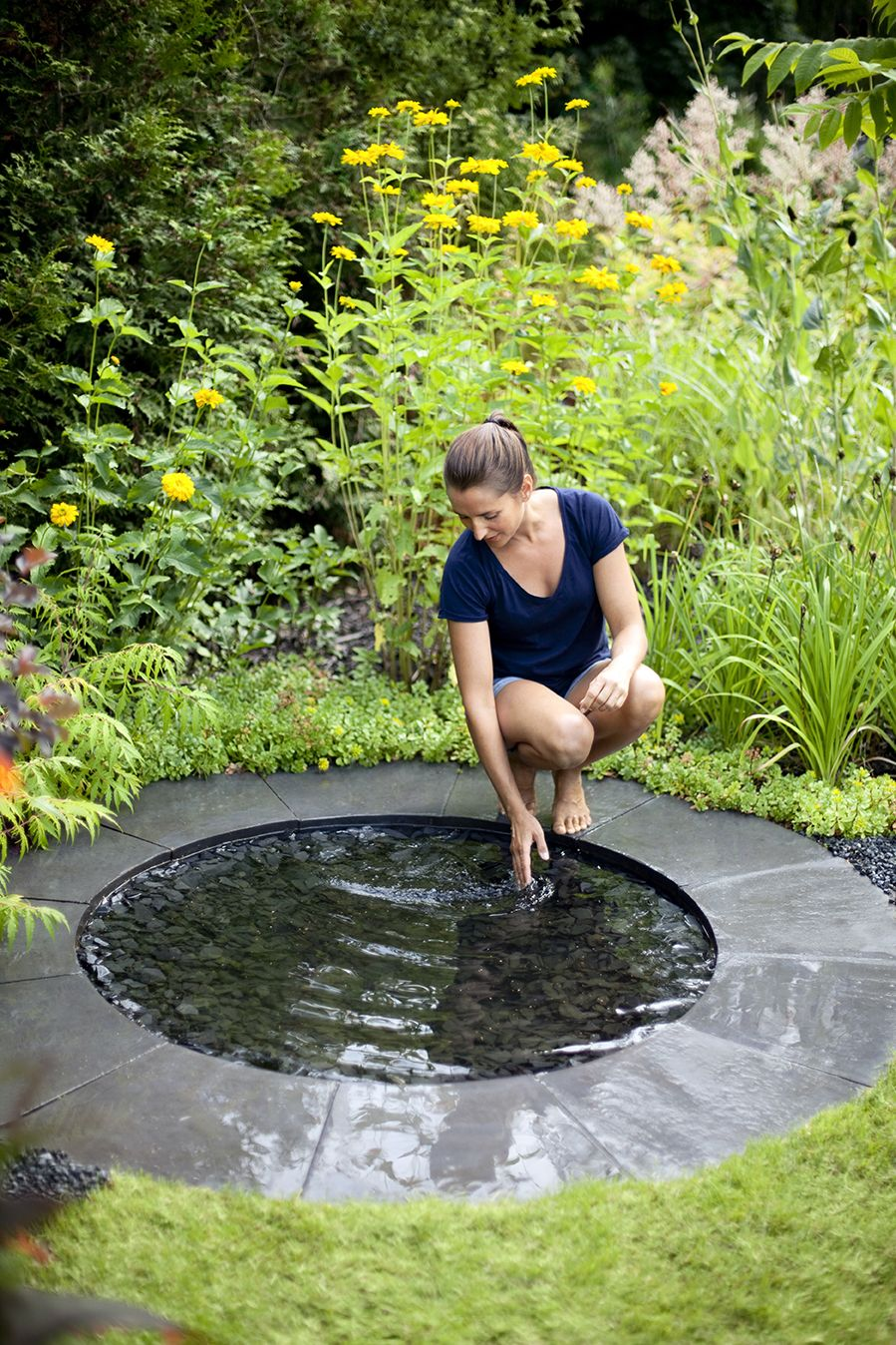 circular stone water mirror for the garden from www.pithandvigor.com