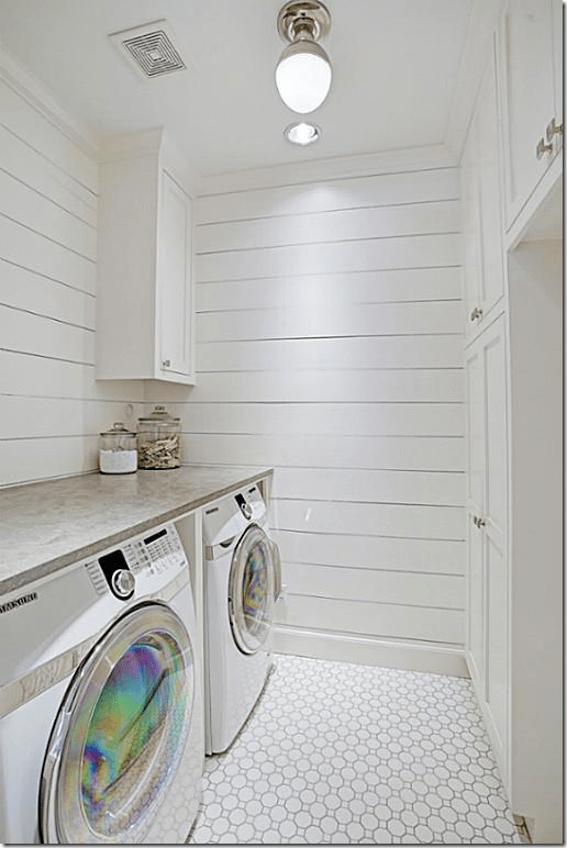 Shiplap and mosaic tile in the laundry room. Cement