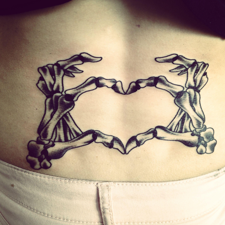 Lower back tattoo. Heart shaped skeleton hands J∪ṧt ŦҤ