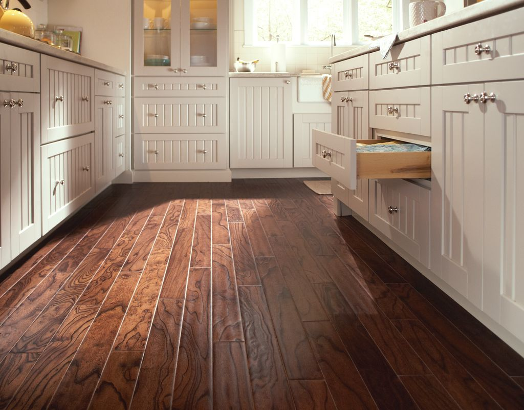 Look beyond tile for your kitchen floor. Wood floors are a