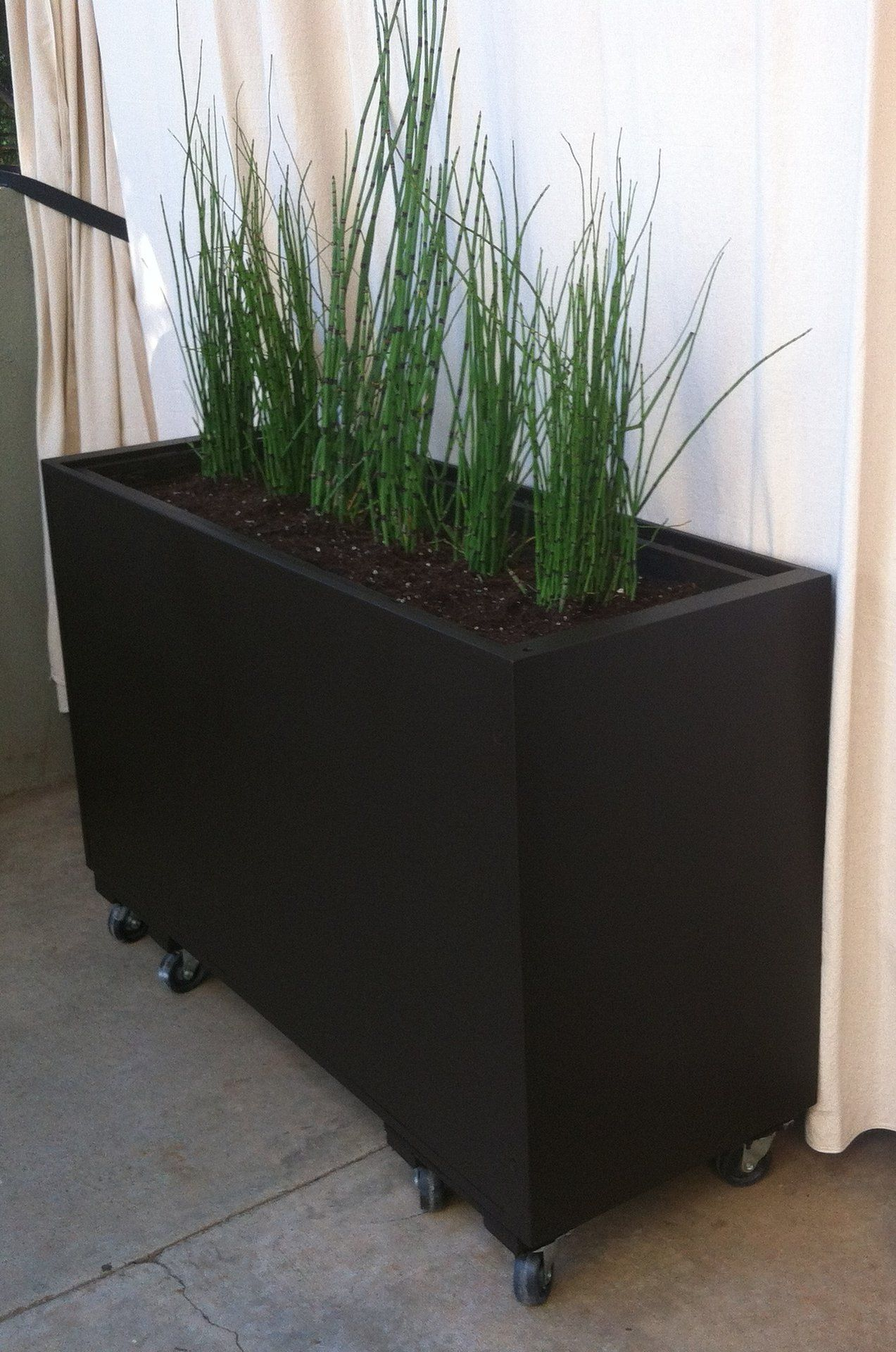Planter from recycled filing on castors use non