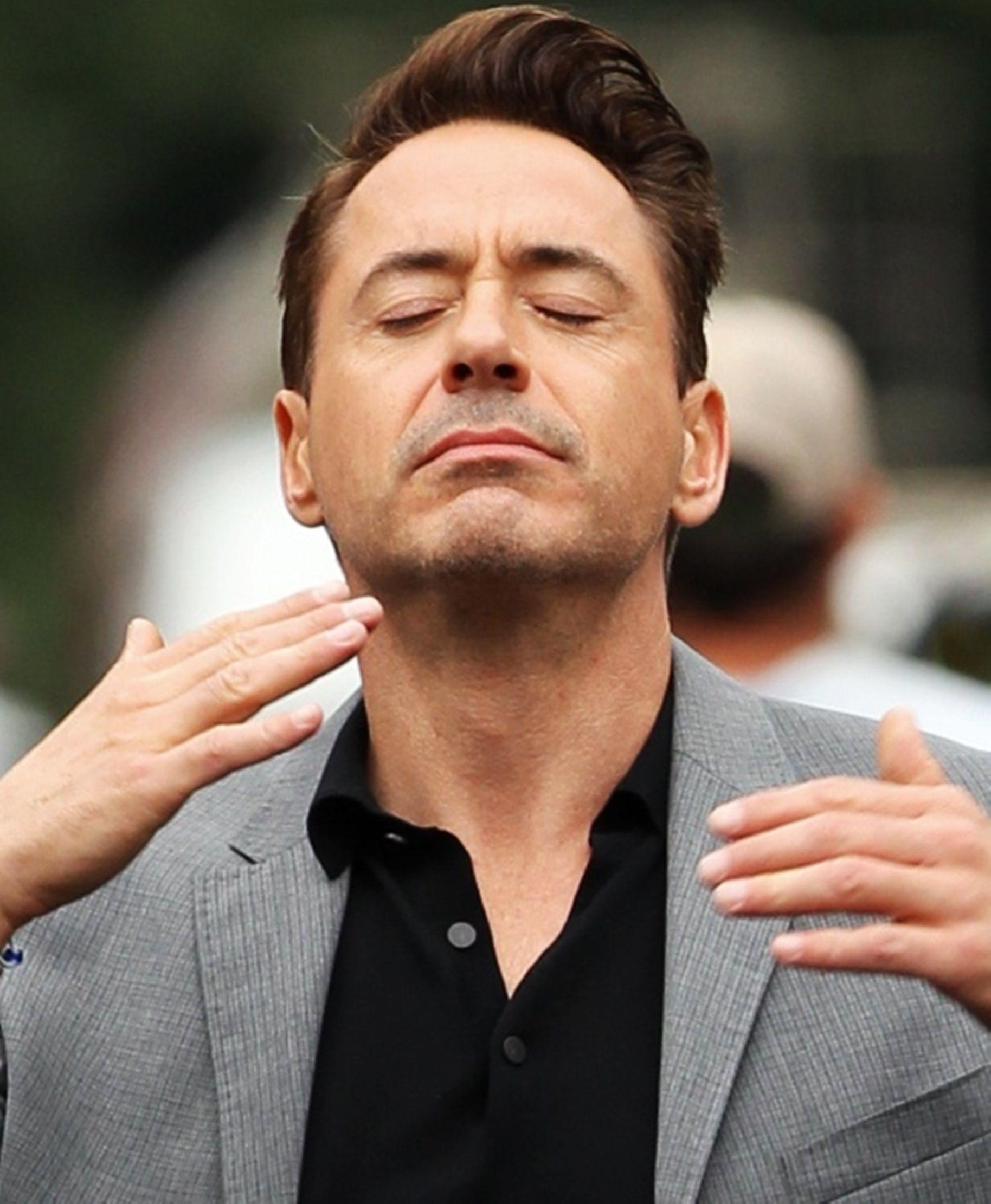 Robert Downey Jr. It looks like he is about to sneeze
