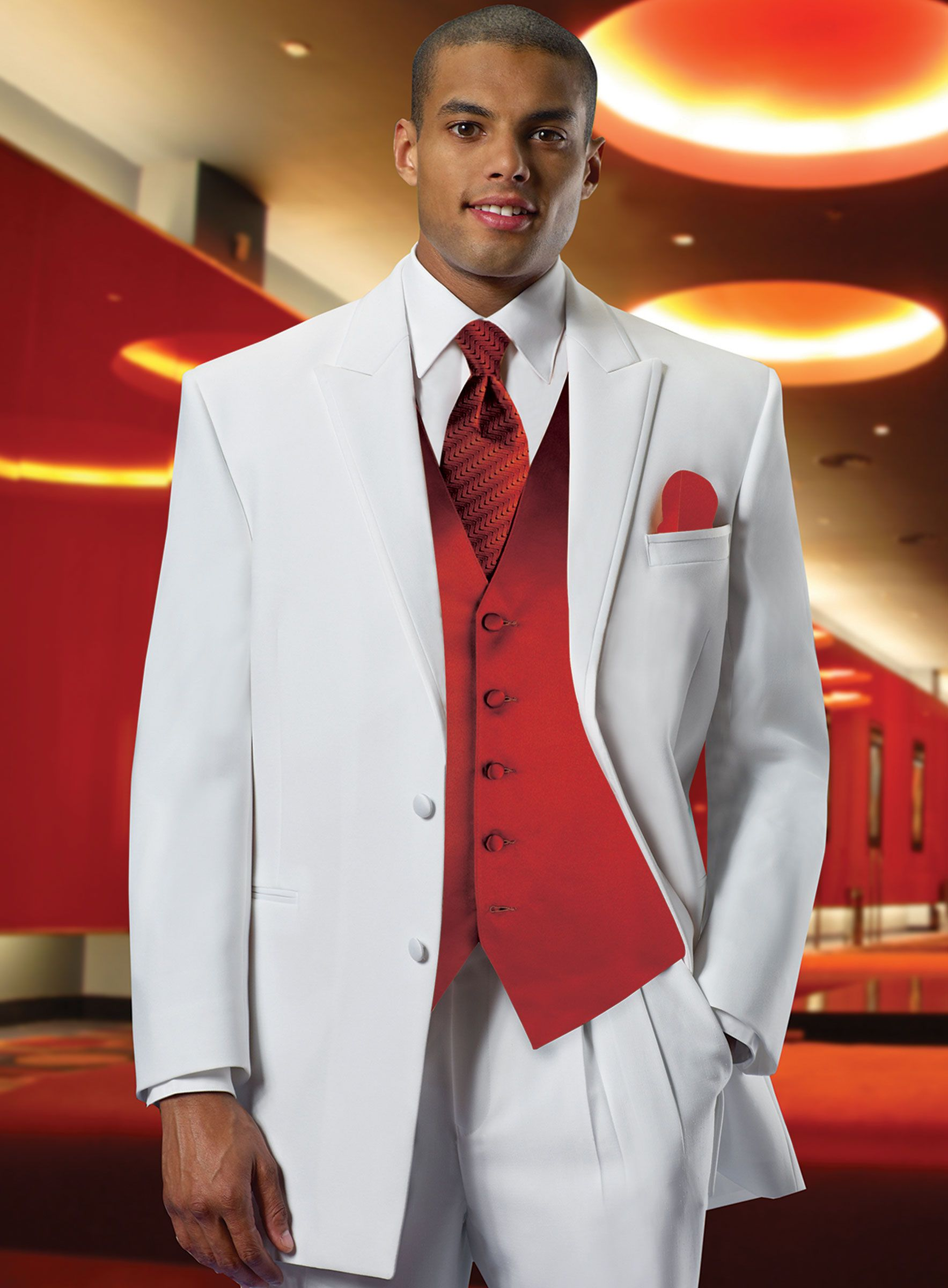 White Tuxedo with Red Vest Red and White Wedding Theme