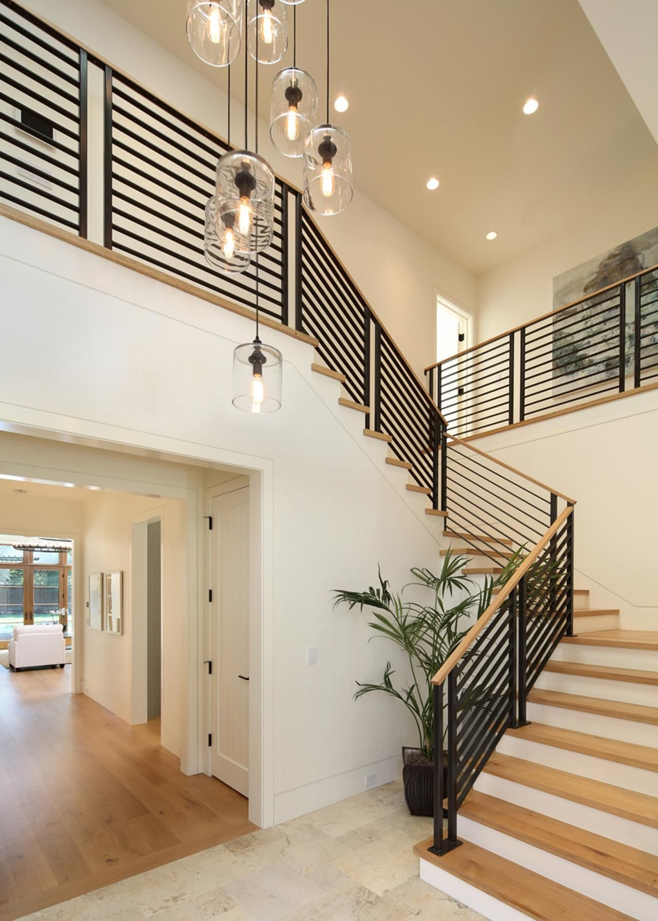 This sleek staircase pairs light hardwood steps with a