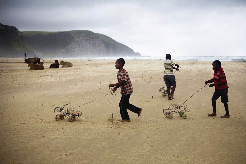 Boys with handmade wire cars, Coffee Bay, Wild Coast