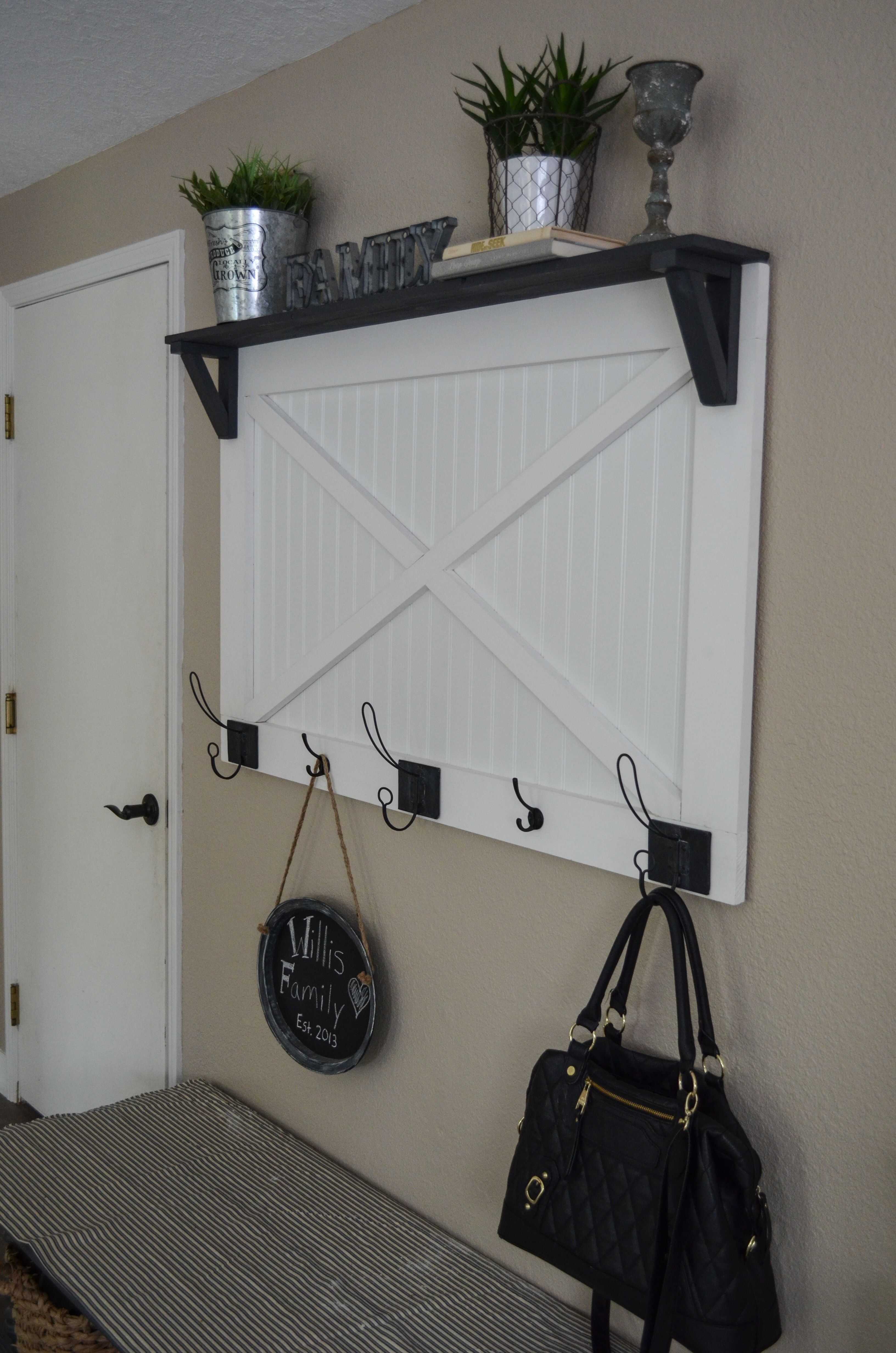 DIY Farmhouse coat rack with hobby lobby hooks. Barn door