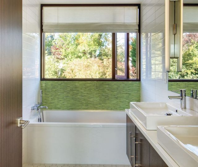 A Courtyard Of Stone Walls Greets The Owners At The Entry Where A Small Bridge  C B Modern White Bathroomwhite