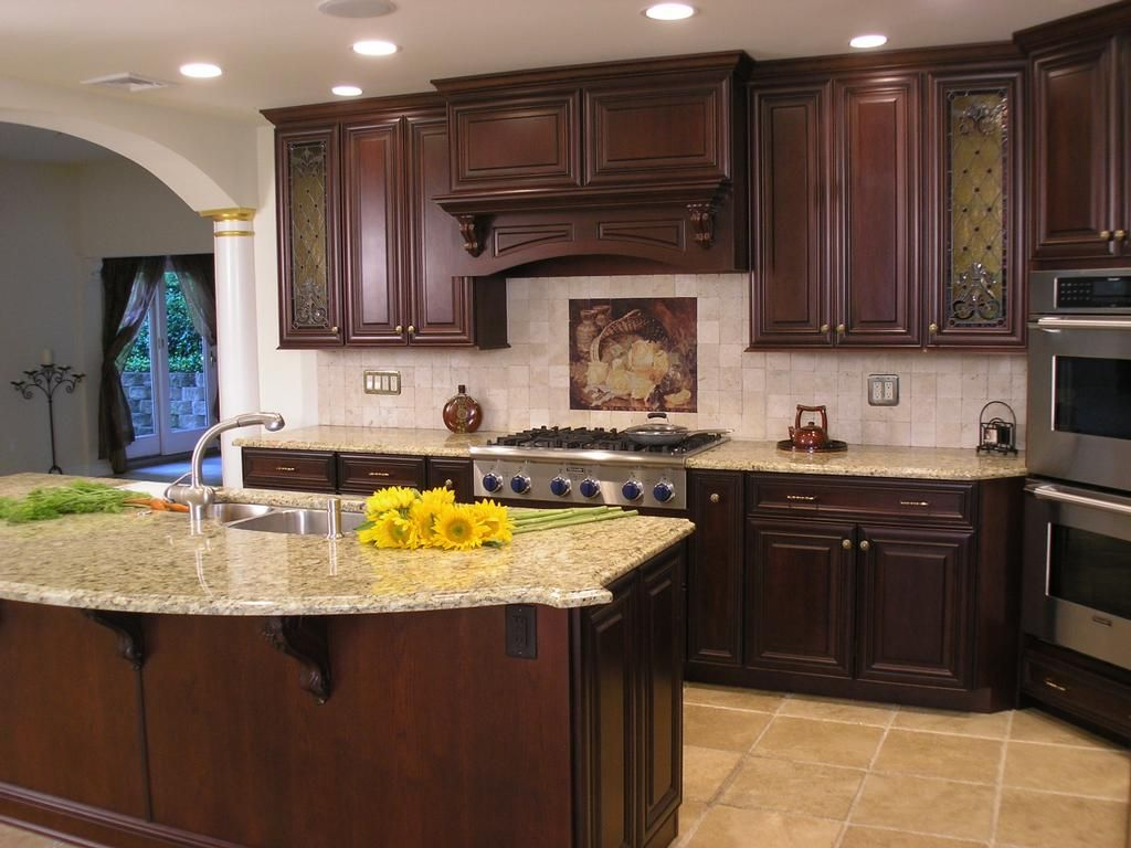 cherry cupboards with light granite countertops {for