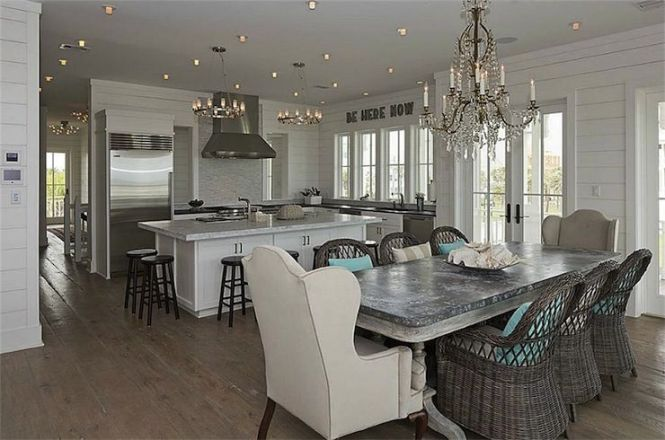 Beach Cottage Kitchen With Crystal Chandelier Over Whitewashed Dining Table Zinc Top Surrounded By Wicker