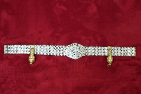 Nyonya belt, with a pair of antique keyholders clipped onto it.