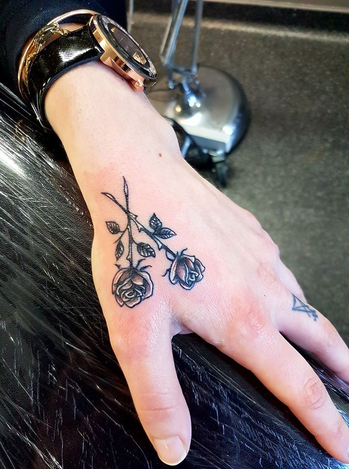 Black and gray rose, white highlights, hand tattoo
