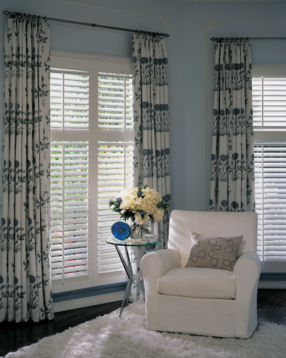 Curtains over top of shutters for less light at night
