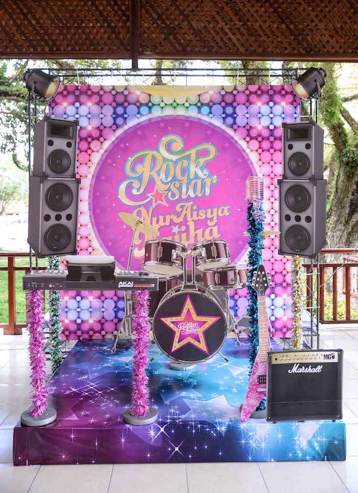 Stage backdrop from Purple Girly Rock Star Birthday Party