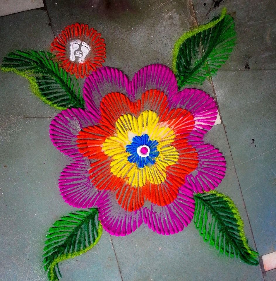 Marigold flower with crepe paper Rangoli designs, Diwali