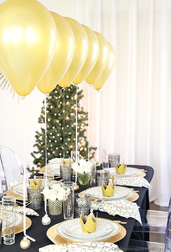 Holiday Table Setting with Balloons Centerpiece Dinner