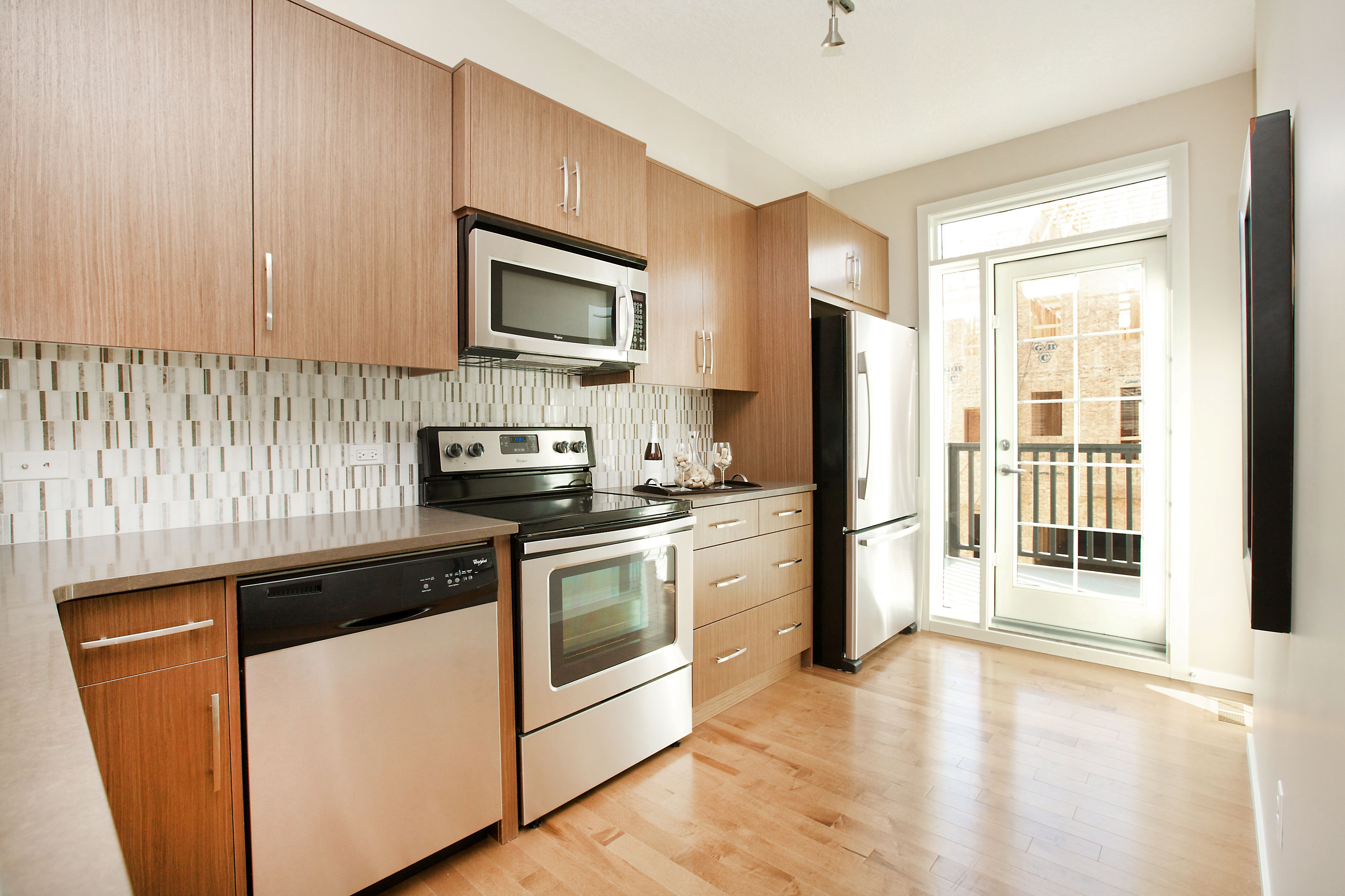 Modern kitchen with flat panel brushed chrome