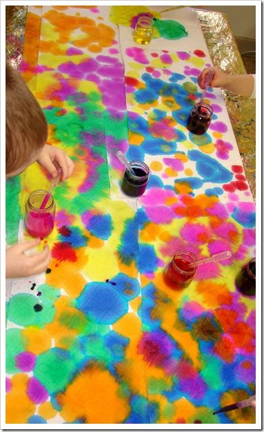 abstract art with droppers, liquid water colors, and paper towels – beautiful and great for fine motor development