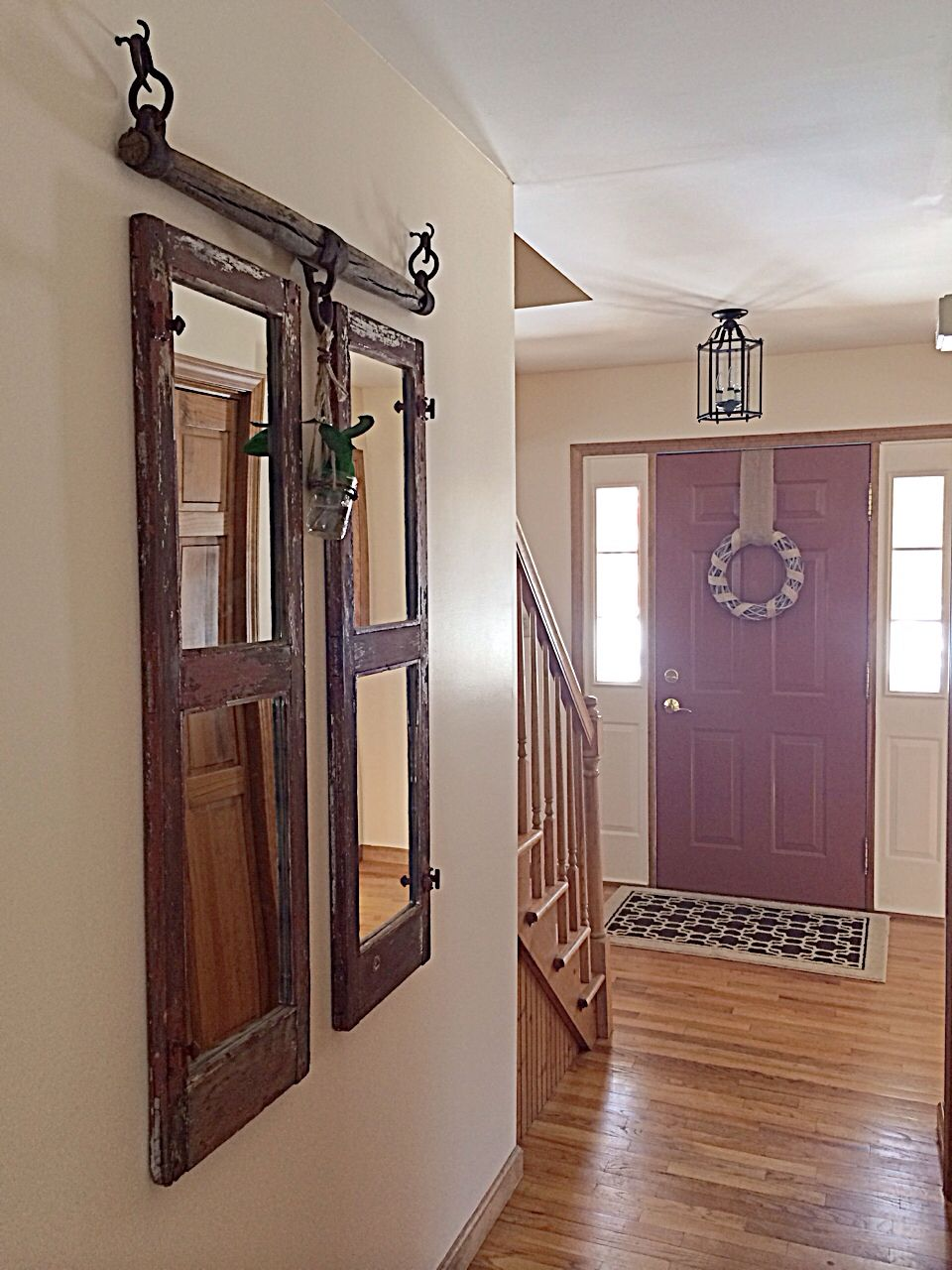 Front Entry with chippy old window mirrors and horse yoke
