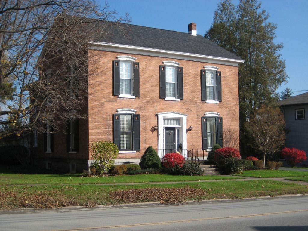 Exterior Elements: Peach Brick Georgian Colonial Home On