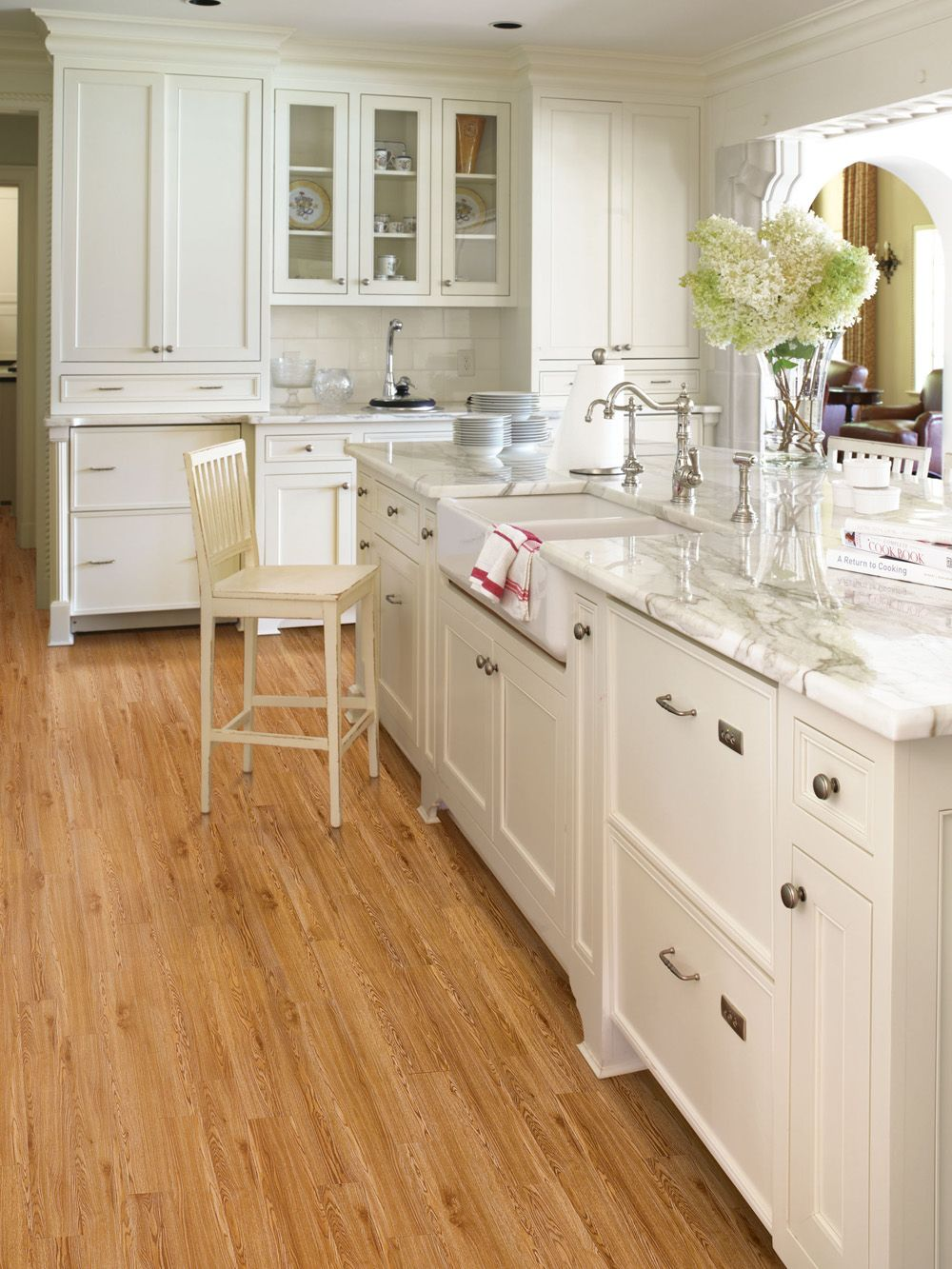 For a cozy yet modern kitchen, pair your light wood floors