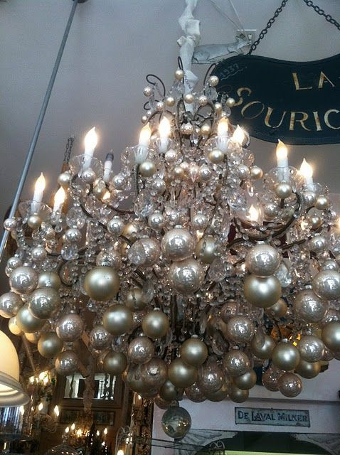 Silver Christmas Ornaments Hanging From A Chandelier Gorgeous