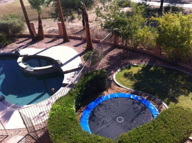 A pool and a inground trampoline in one yard awesome
