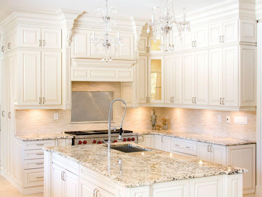 White kitchen with delicatus granite countertops