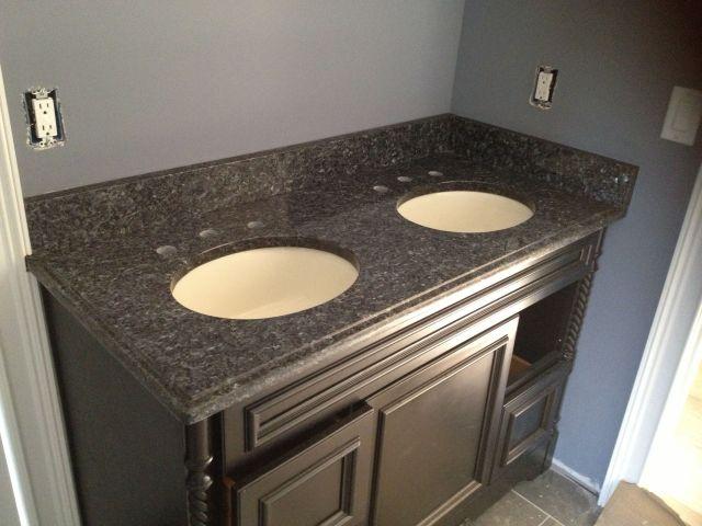 Blue pearl granite vanity top Not sure I like dark cabinets with