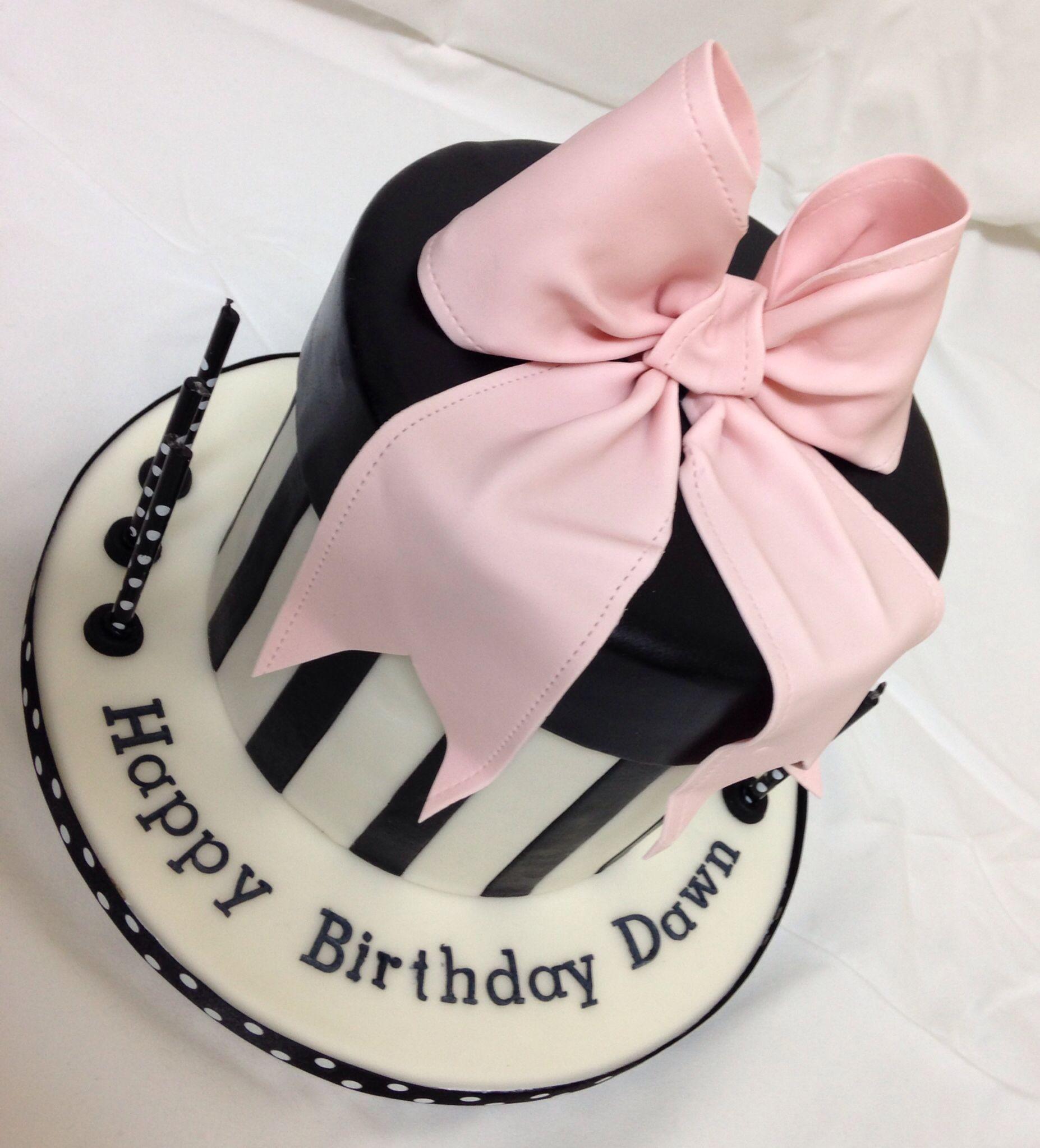 Round gift box cake with gum paste bow black white cake