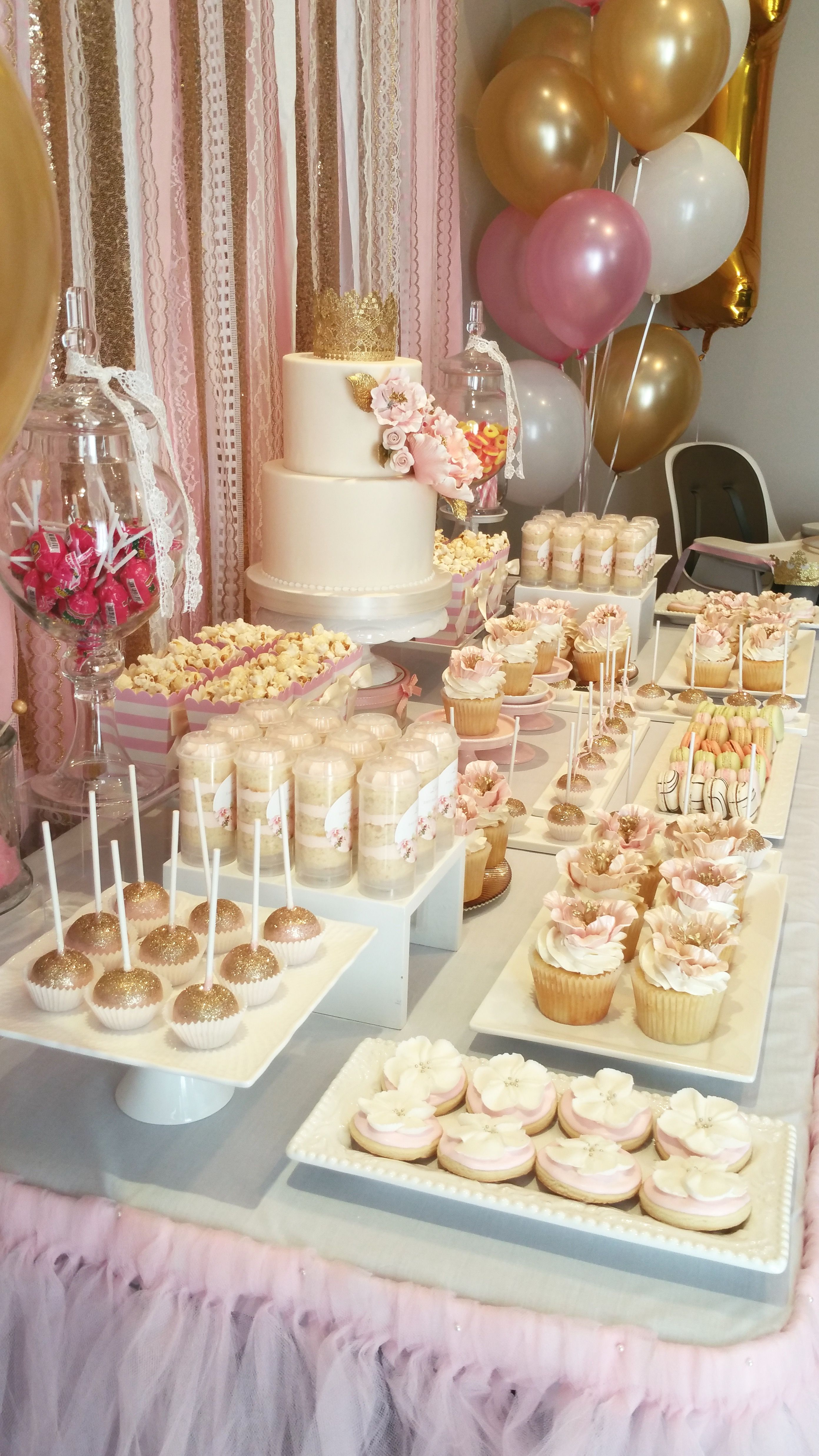 Pink and gold first birthday Bobbette & Belle sweet table