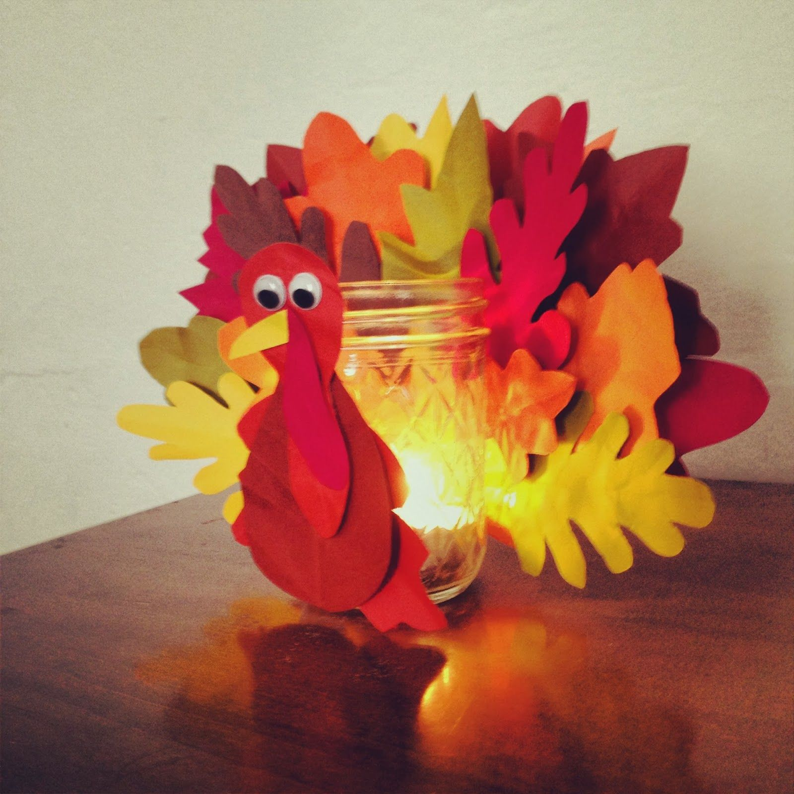 DIY turkey jar craft with paper leaves for