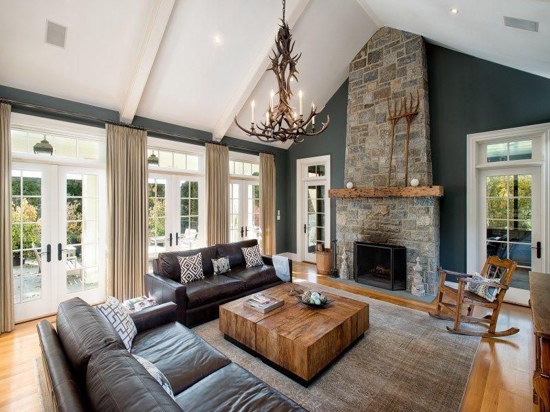Rustic Living Room With Hardwood Floors Chandelier Stone