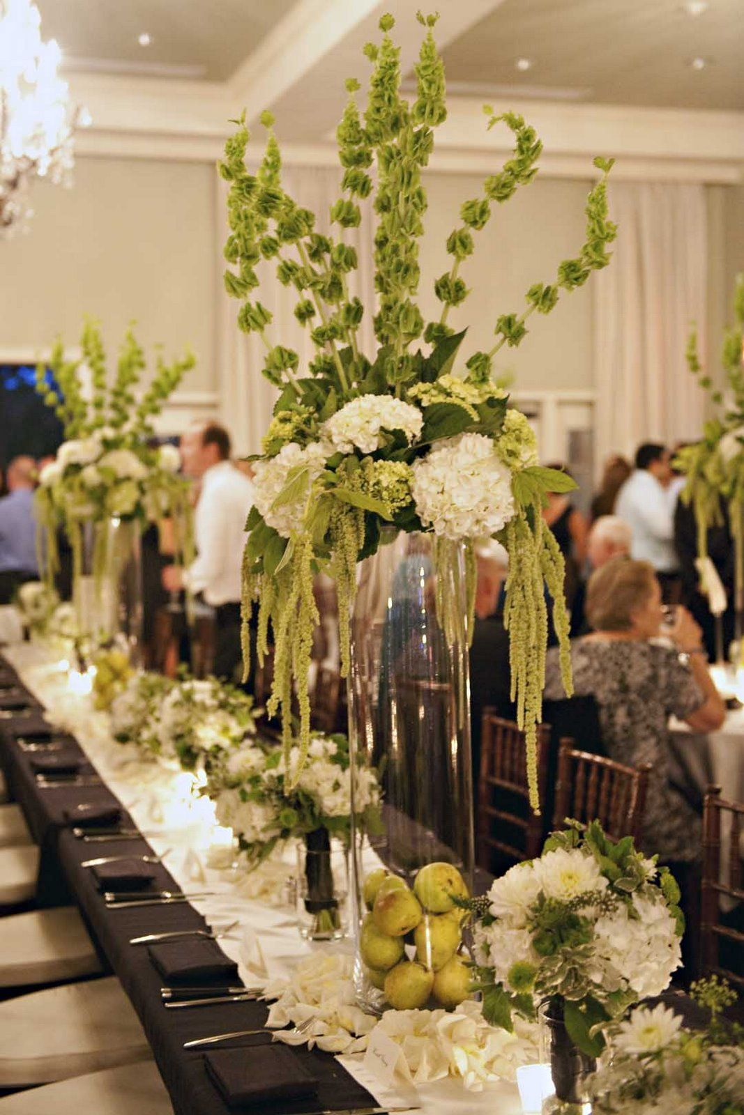 green and white arrangements of hydrangea, bells of