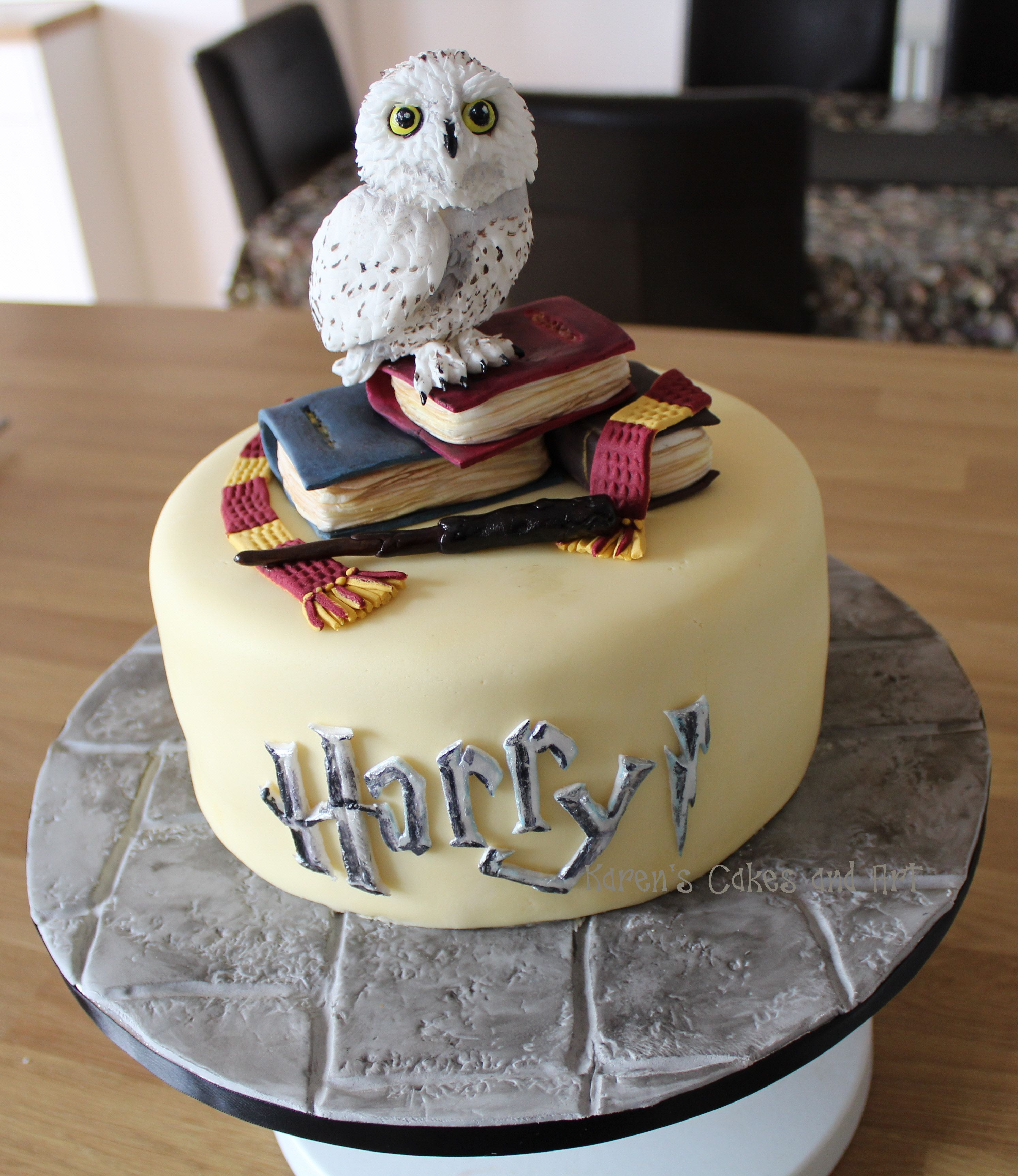 Harry Potter themed cake little Hedwig with spellbooks