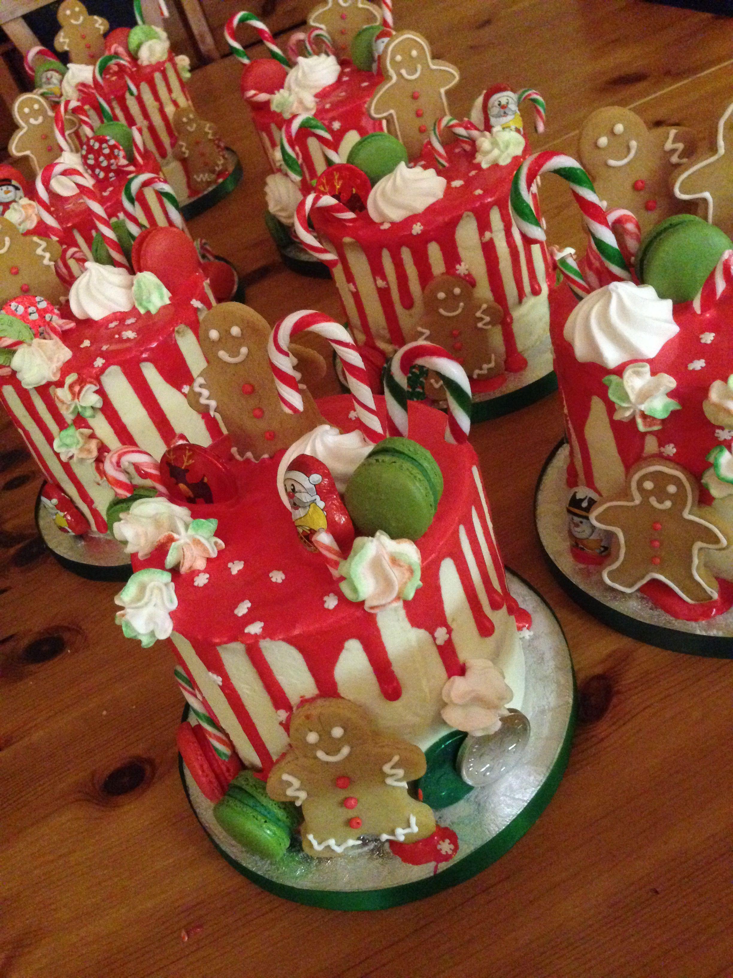 Christmas drip cake. Homemade ginger bread men, macaroons