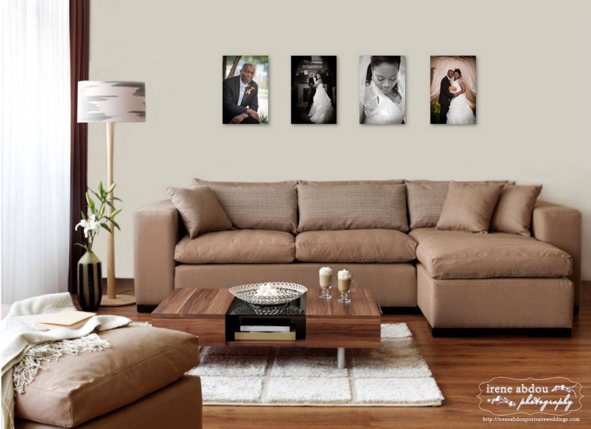 here are four 12x18 mounted prints displayed on a wall behind a 95