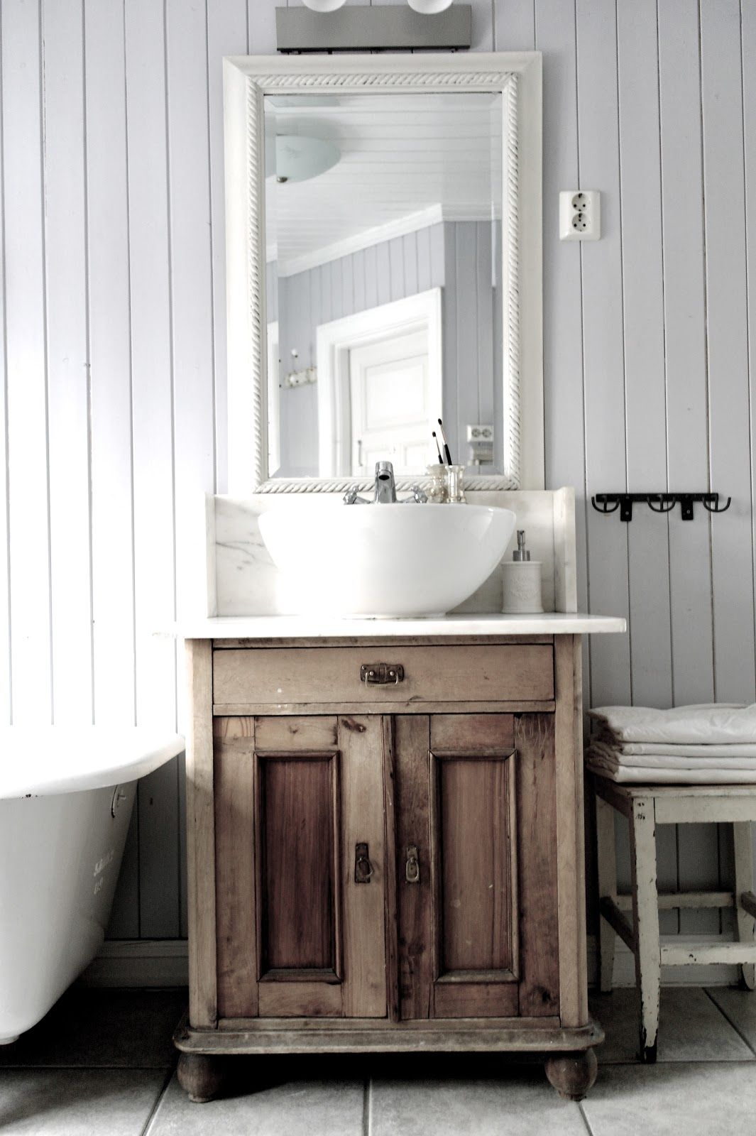 Vintage Interior Antique stand used as bathroom vanity