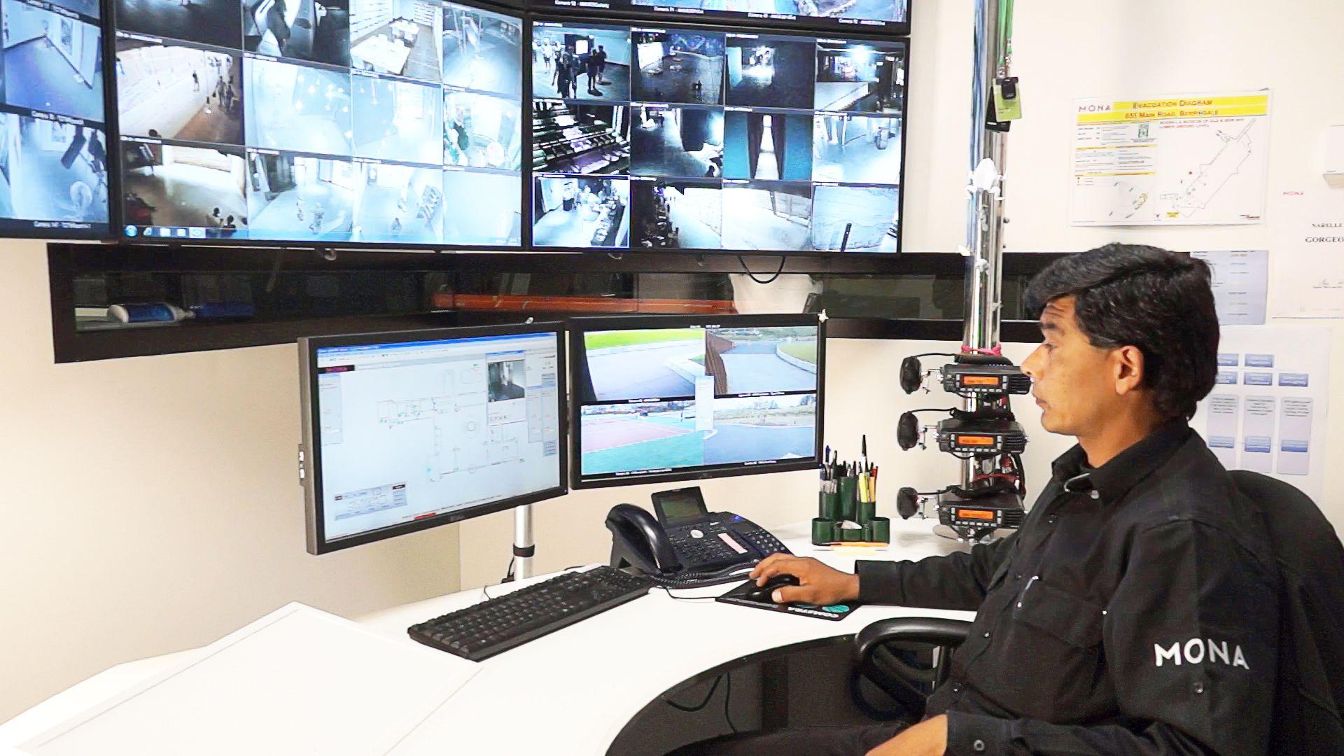 SecurityOfficerincontrolroom.jpg 1,920×1,080 pixels