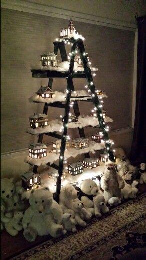 Christmas Village Displayed On Old Wooden Ladder