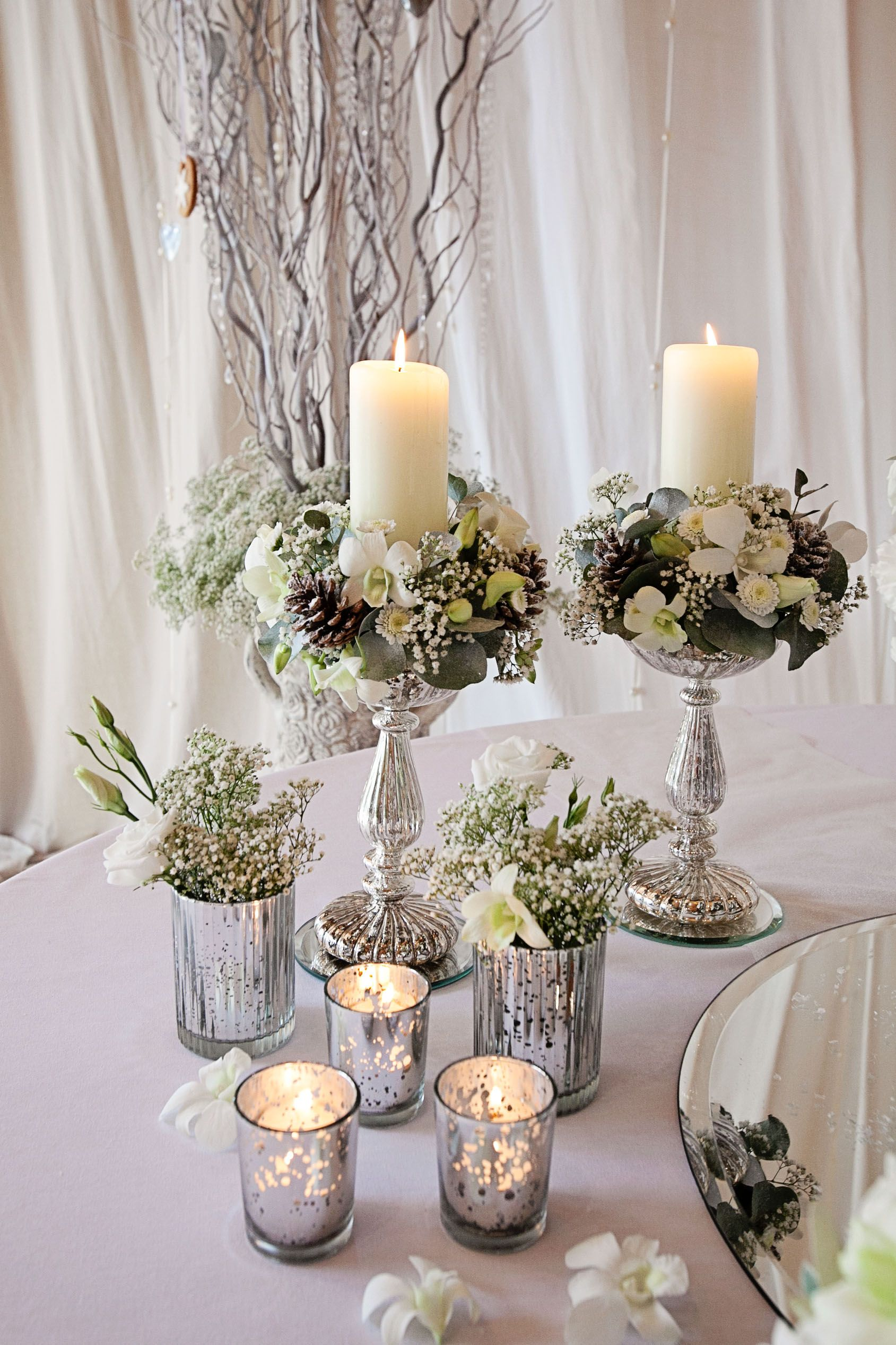 tiara flower arrangements Candle stand arrangements and